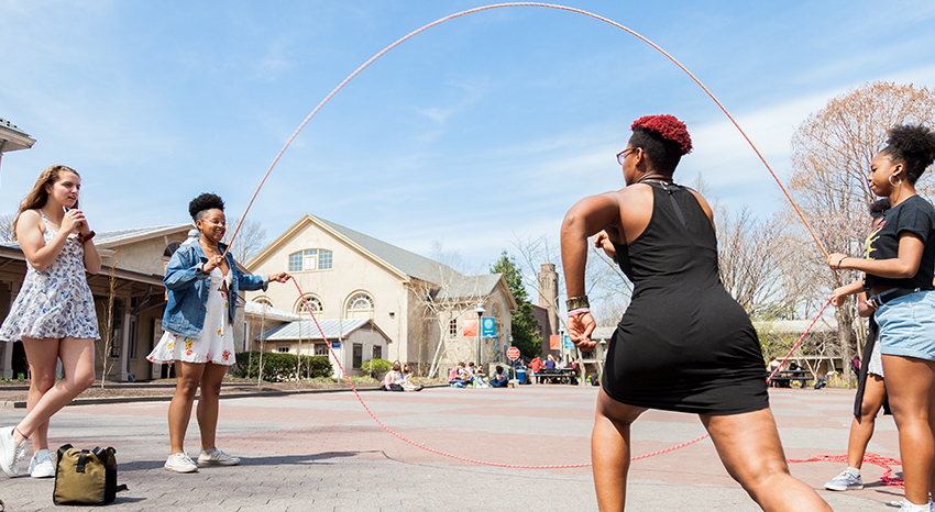 Girls playing double dutch jump rope on the Common